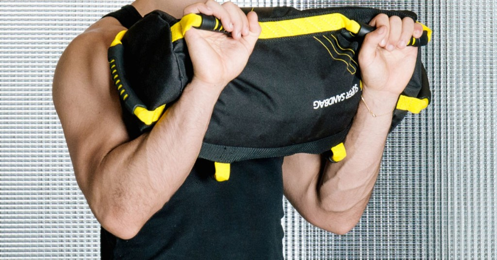 12 Sandbag Exercises That Work Twice as Many Muscles in Half the Time