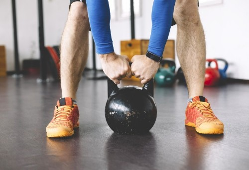 Which Are More Effective: Dumbbells or Kettlebells?