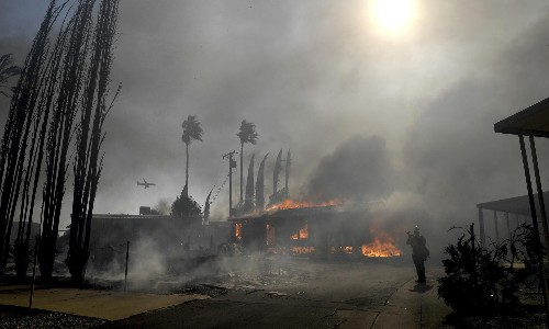 California: north and south battle wildfires as preventive shutoffs hit millions