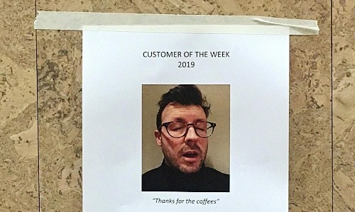 Great Australian cafe war ends with 'insanely painful' coffee cup tattoo