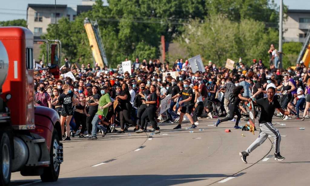 Truck drives through crowd of protesters on Minneapolis bridge