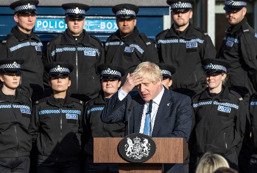 Dazed and confused, Johnson stumbles into the twilight zone with a police escort