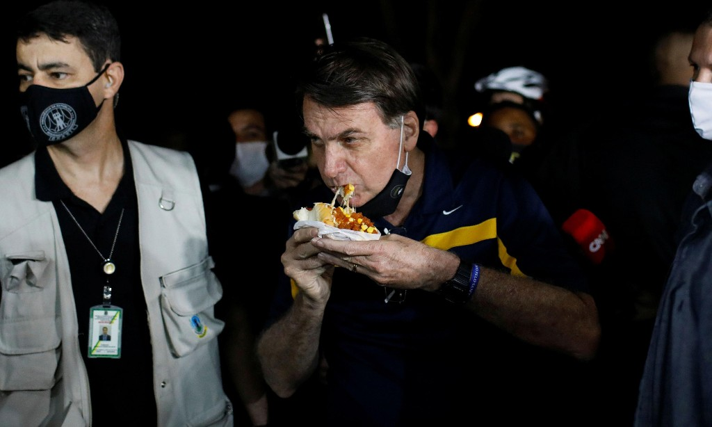 Jair Bolsonaro branded a 'killer' during hotdog trip as Covid-19 death toll soars