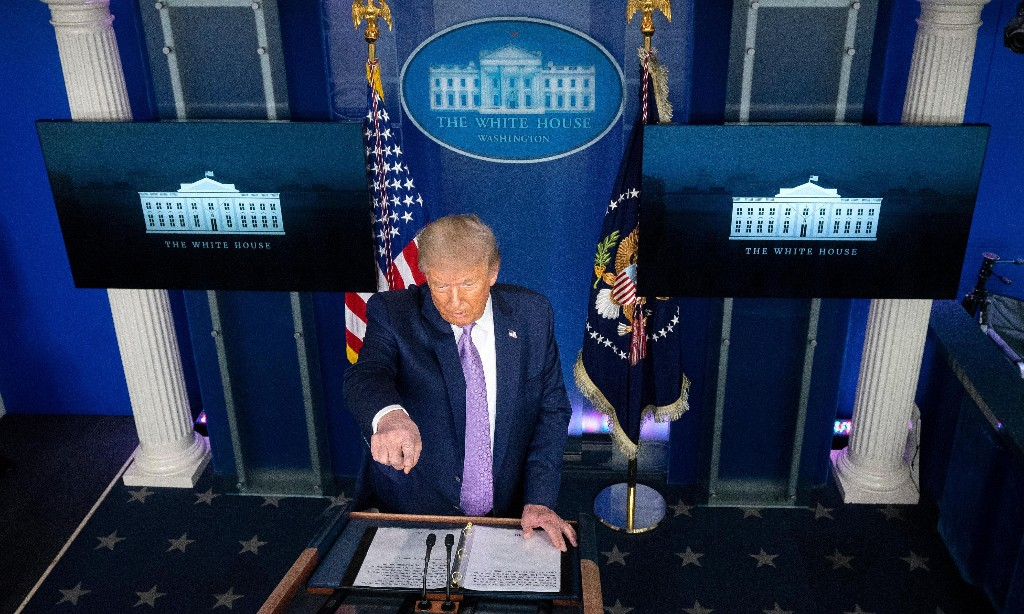 Trump again claims Covid-19 will 'go away' as Fauci warns of long road ahead
