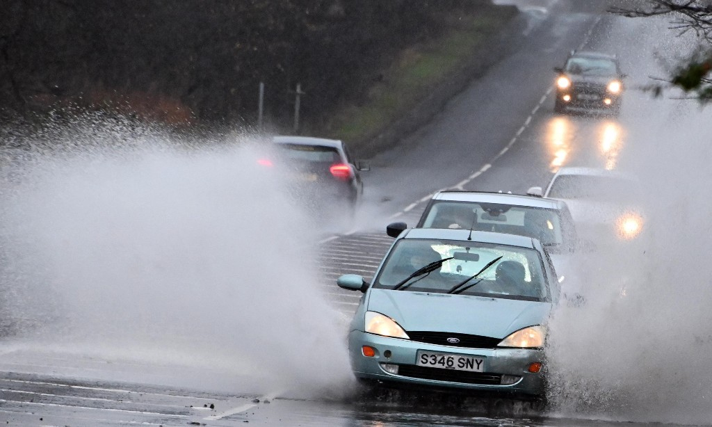 Heavy rainfall prompts flood warnings and travel disruptions in UK