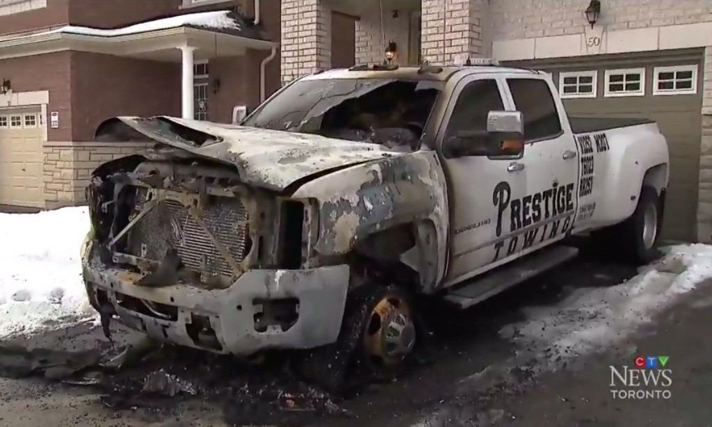 Canada police arrest 20 and bring hundreds of charges in violent tow truck turf wars