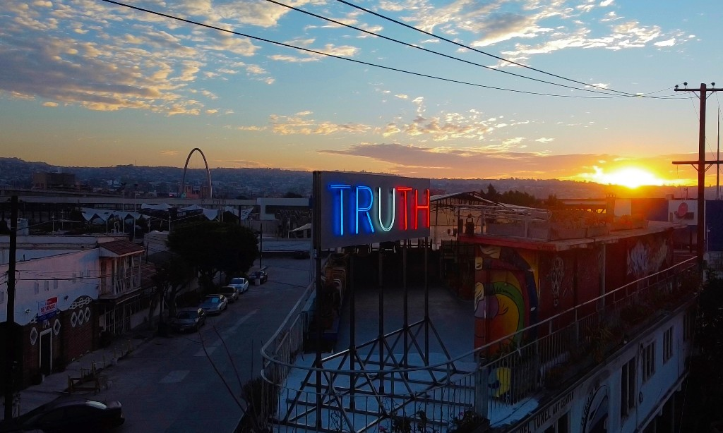 'Truth and lies have eroded': why an artist took over a billboard at the US-Mexico border