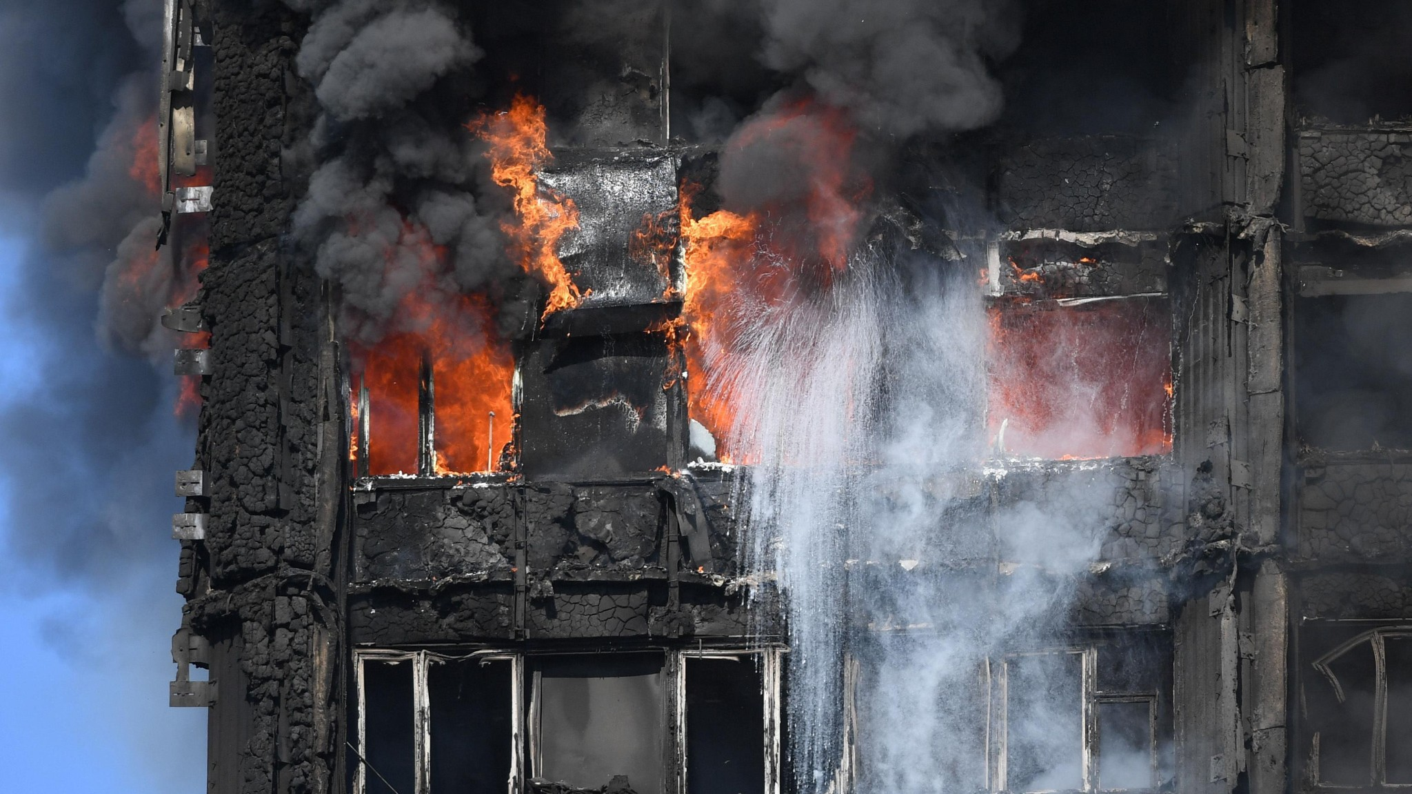 Grenfell Tower: at least six dead as fire destroys 24-storey building