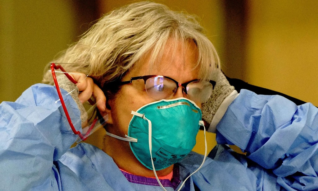 Anger in North Dakota after governor asks Covid-positive health workers to keep working