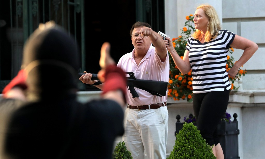 Trump retweets video of white St Louis couple pointing guns at protesters