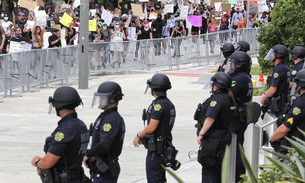 What does 'defund the police' mean? The rallying cry sweeping the US – explained