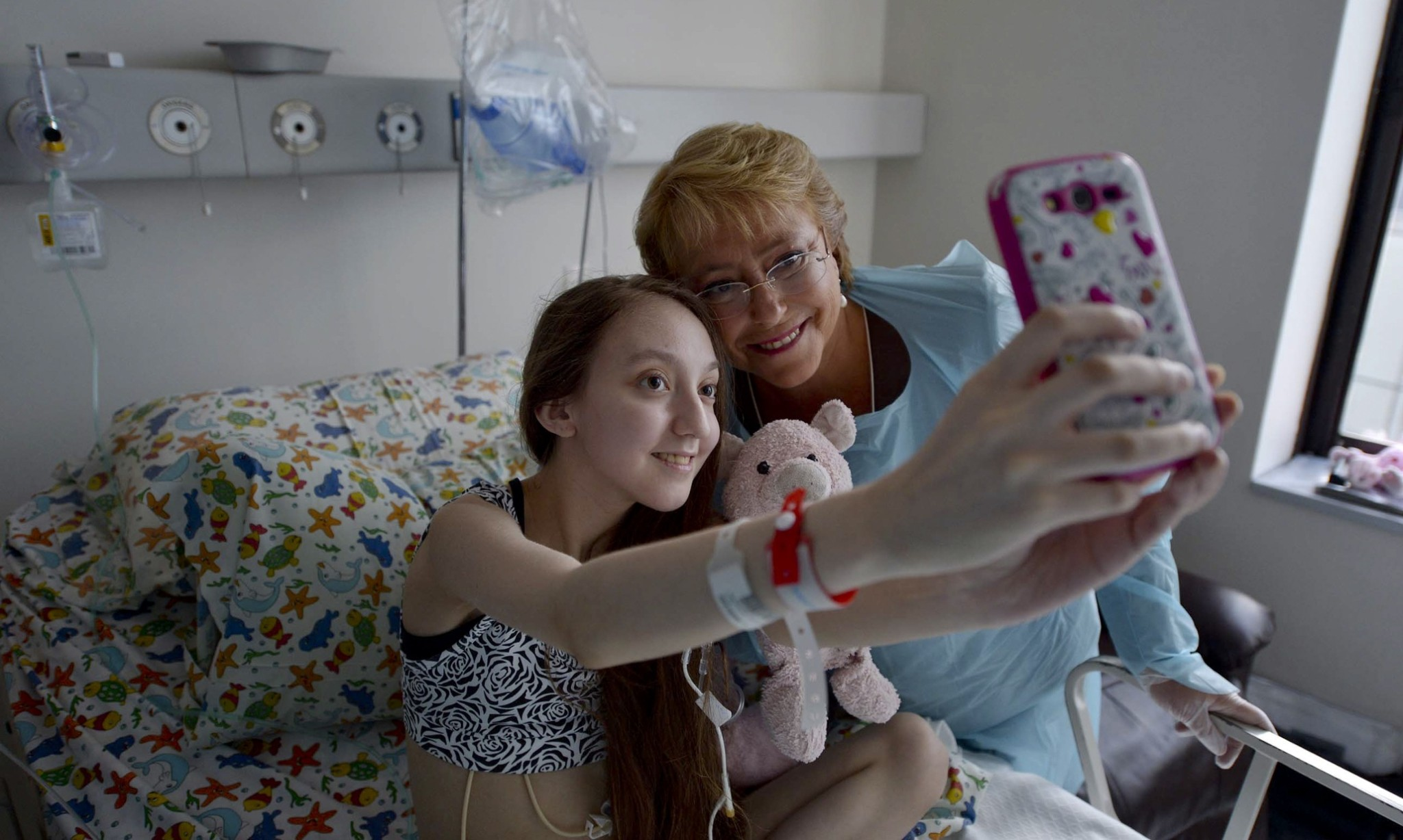 Chile president visits girl with cystic fibrosis who posted euthanasia video