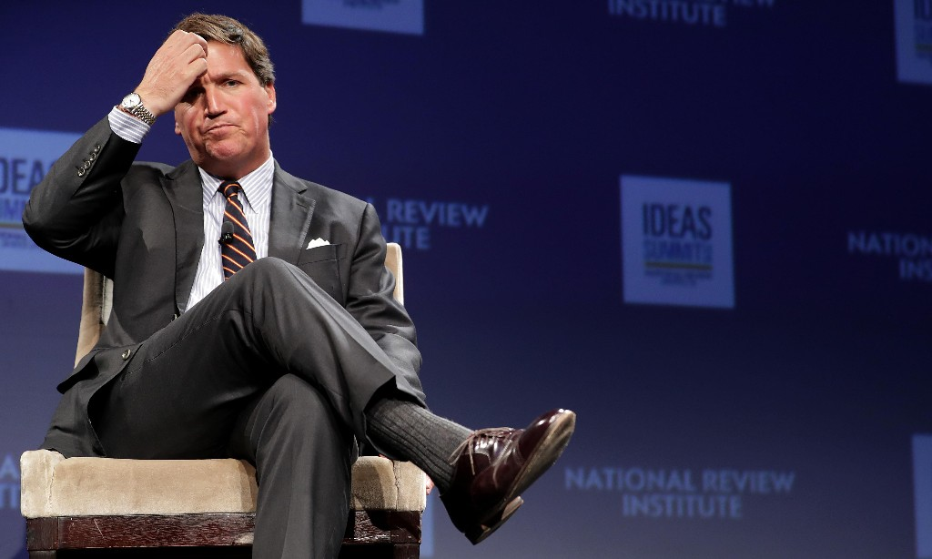Tucker Carlson announces vacation after writer resigns over racist remarks
