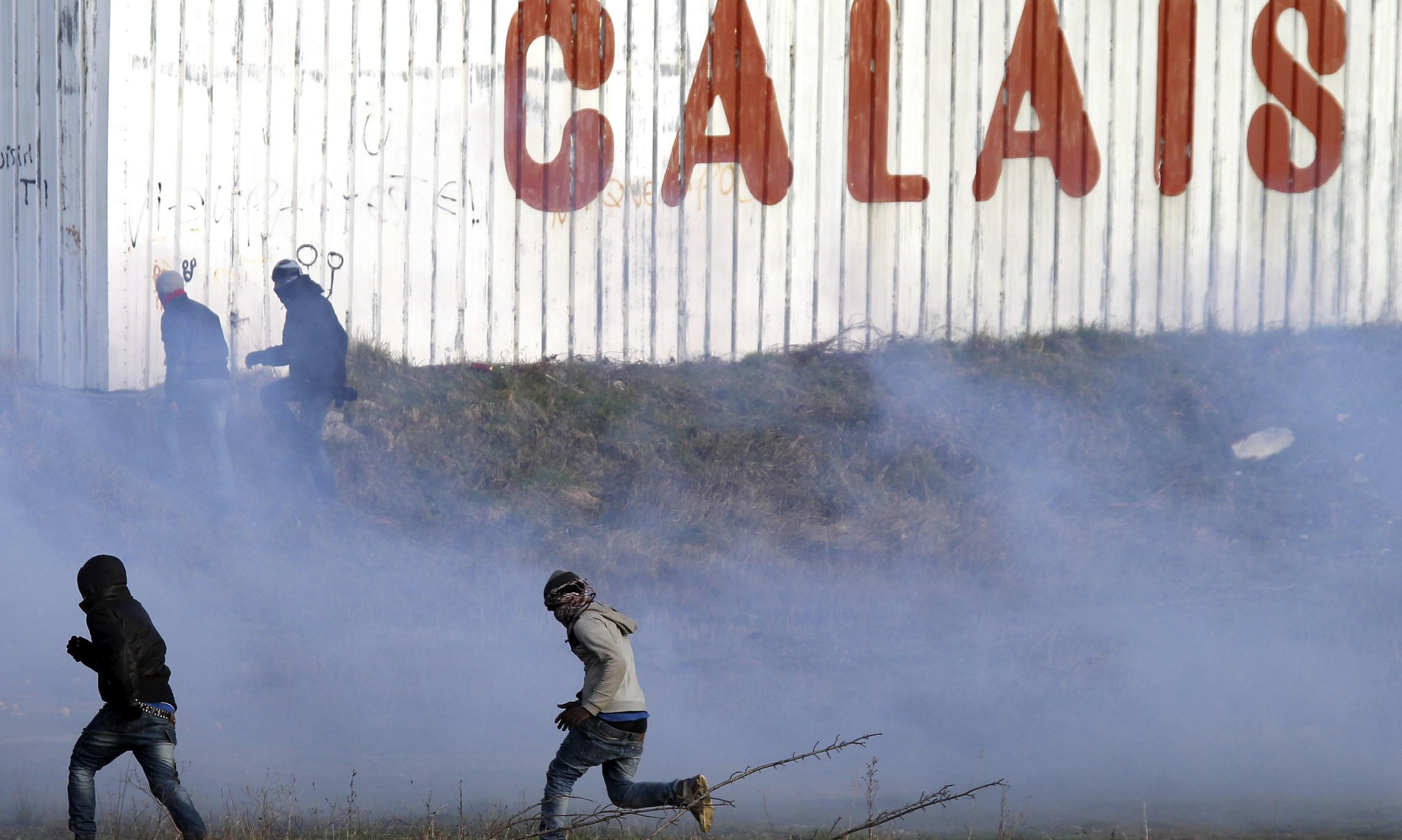 France vows to maintain order in Calais after migrants board ferry