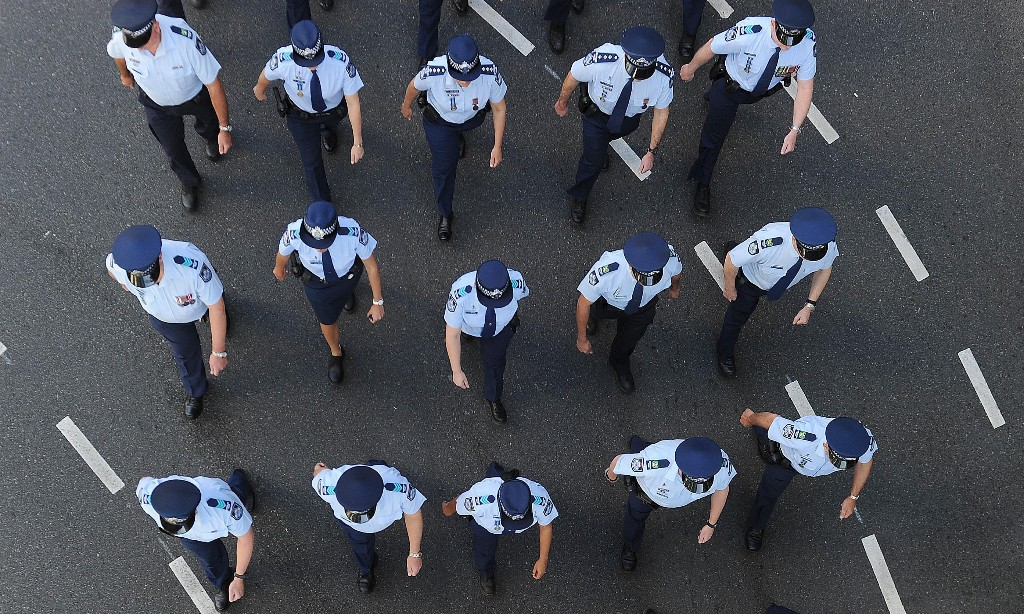 Queensland police cracks down on 'unapproved' uniform patches linked to far-right groups