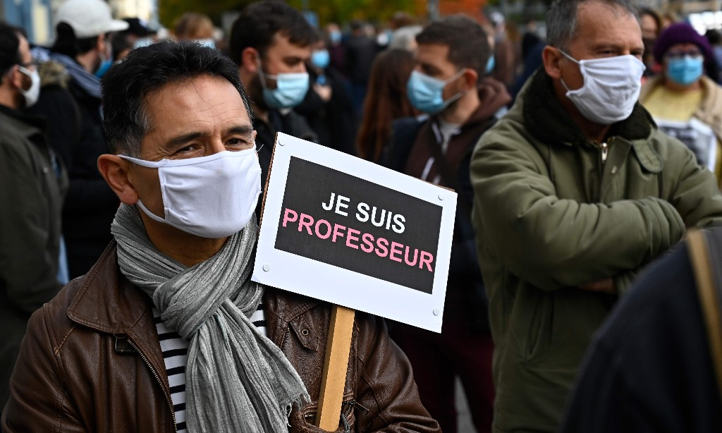French teachers vow to 'teach difficult subjects' after colleague's murder