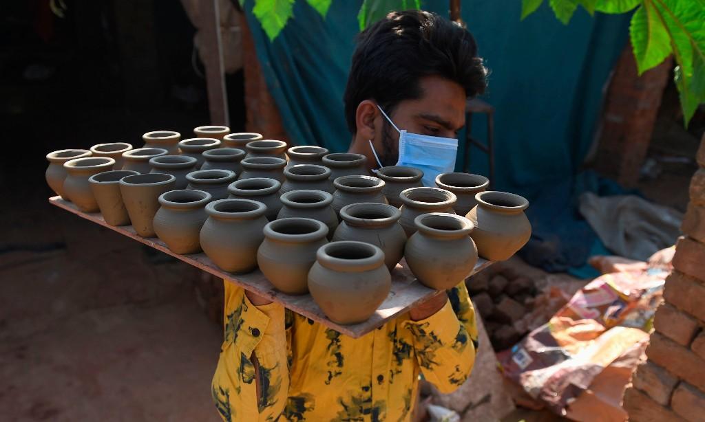 All change: India's railways bring back tea in clay cups in bid to banish plastics