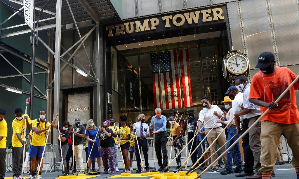 New York City mayor helps paint 'Black Lives Matter' outside Trump Tower