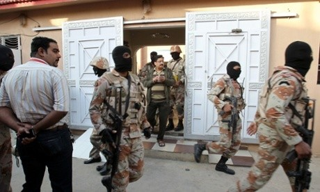 Pakistan paramilitary forces raid opposition party's Karachi HQ
