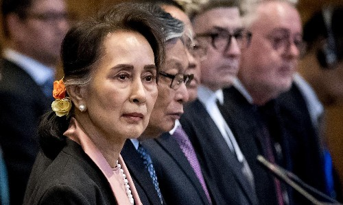 Aung San Suu Kyi in court as genocide hearing opens in The Hague