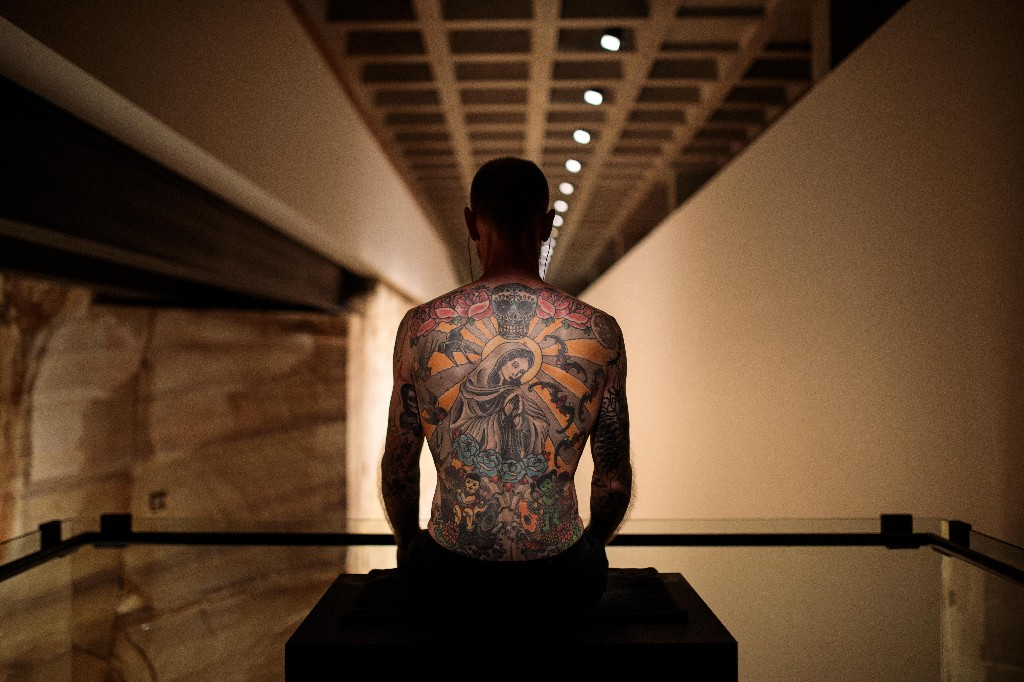 Tim alone: Mona's human artwork is still sitting in the empty gallery for six hours a day
