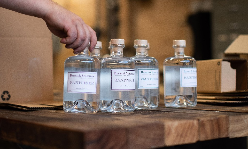 Australian distillers who made sanitiser left with unsold product as cheap imports flood market