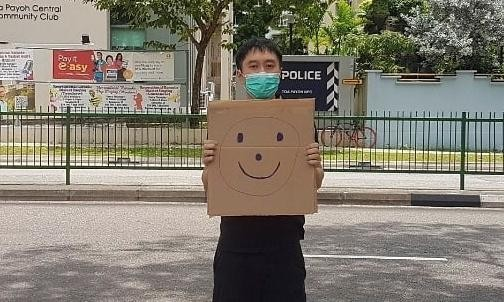 Singapore 'smiley-face' activist in one-man protest charged with unlawful assembly