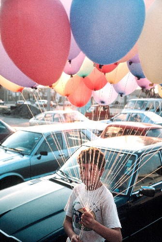 The big picture: boy with balloons in Santiago, Chile
