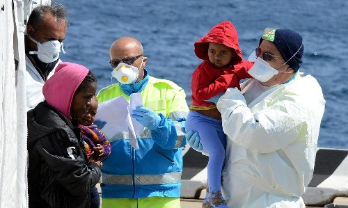 Italy calls for help rescuing migrants as 40 more reportedly drown