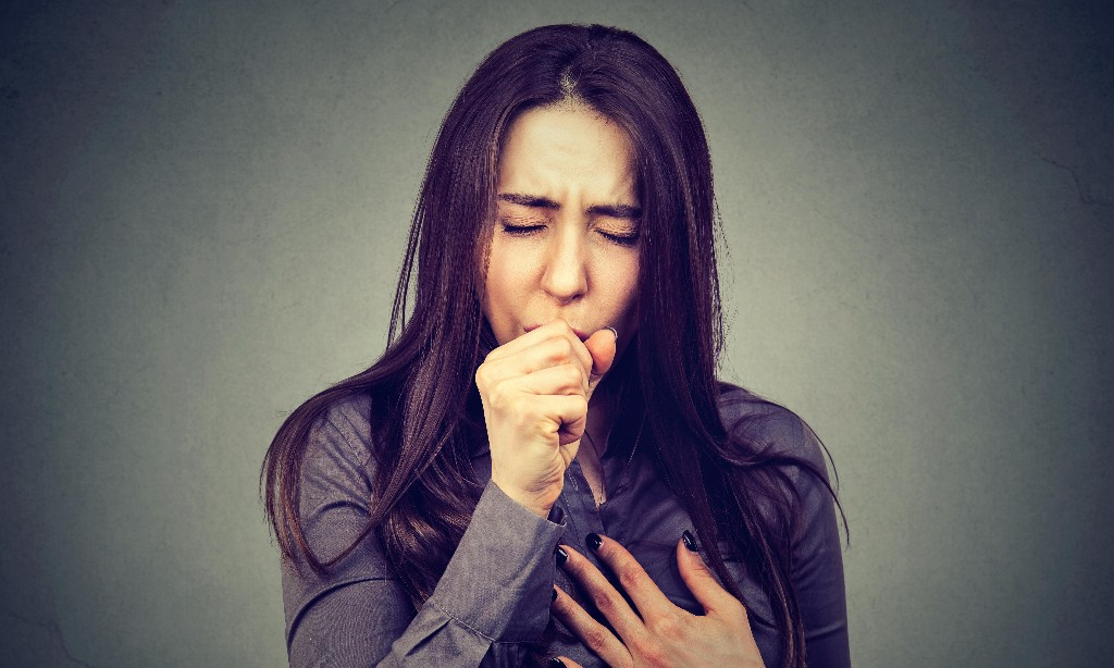 What is a 'persistent cough' and what should I do if I have it?