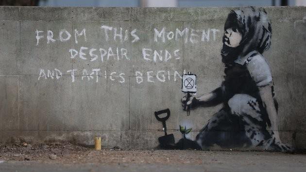 'Banksy' Artwork Mysteriously Appears By Site Of Extinction Rebellion Protests
