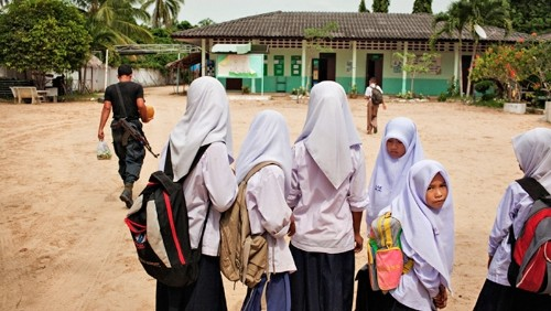 Soldiers in Schools: The Impact of Military Occupations on Education