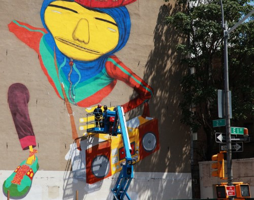 Os Gemeos Pop Through Walls Downtown NYC, Screens in Times Square