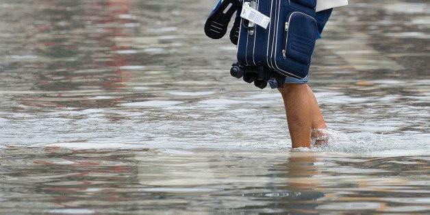 'Acqua Alta' Flooding Returns To Venice, Leaves Tourists Wading