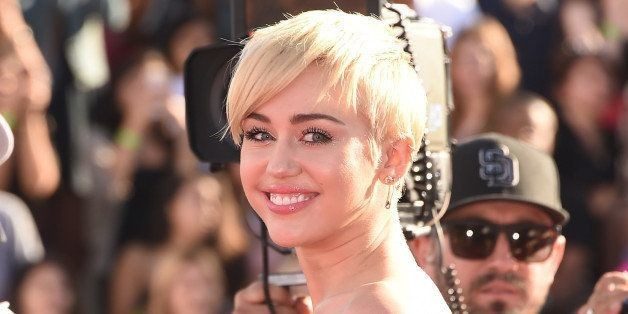 Miley Cyrus Says She Still Loves Former Fiance Liam Hemsworth