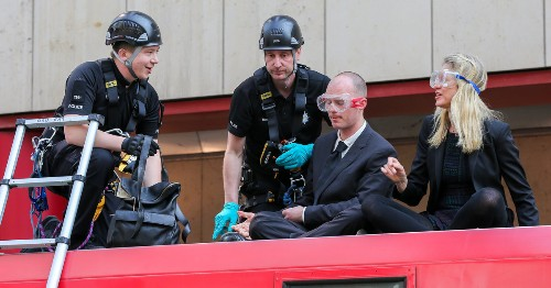 Three Charged Over Extinction Rebellion DLR Train Stunt