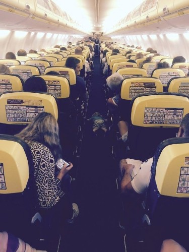 Exhausted Toddler Fell Asleep In Ryanair Plane Aisle After Two Hours 'Helping' Flight Assistants