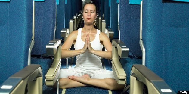 Airplane Yoga: 7 Poses To Try On Your Next Long Flight