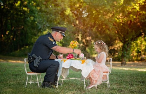 Cop Has Tea Party With Little Girl To Honor The Day He Saved Her