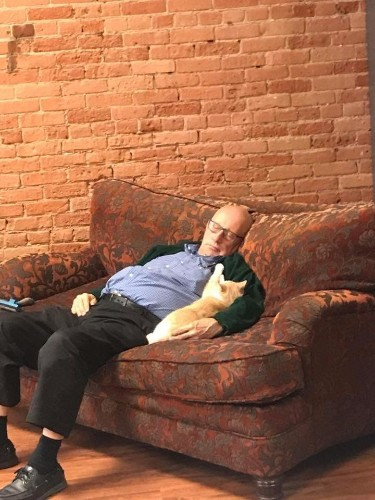 75-Year-Old Volunteer Visits Animal Shelter Every Day And Naps With Cats
