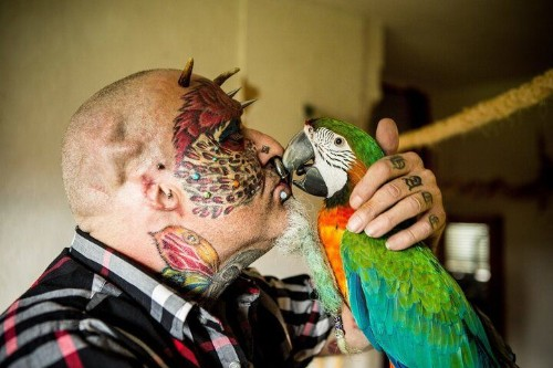 BIRD BRAIN! Man Cuts Off Ears To Look More Like His Parrot