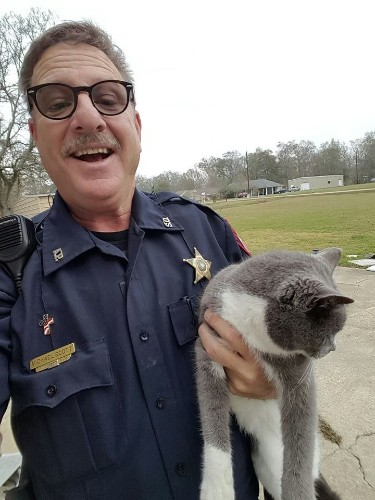 Community Teams Up To Save Cat Found Hanging From Garage Door