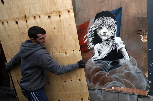 Banksy Criticizes Use Of Tear Gas On Refugees In New Mural