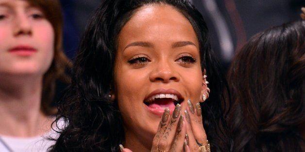 Rihanna Got A New Cross Tattoo On Her Wrist
