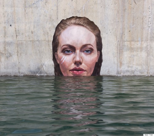 From A Stand-Up Paddleboard, A Street Artist Brings Life To Abandoned Waterfront Buildings