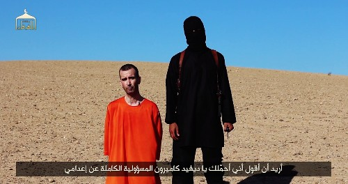 ISIS Video Claims To Show Beheading Of British Aid Worker David Haines