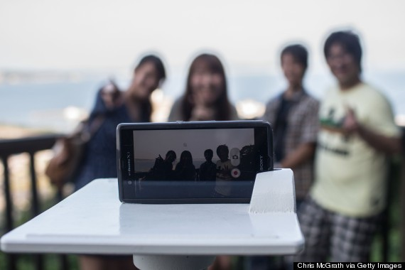Japan's Selfie Stands Take Tourist Photos To A Whole New Level