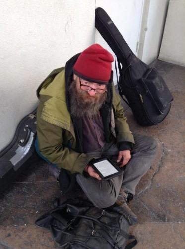 A Homeless Man Read His Only Book Over And Over, So A Compassionate Stranger Gave Him A Kindle