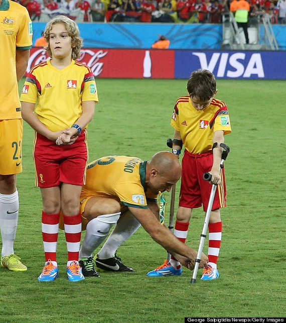 World Cup Player Stops To Tie Shoe For Boy On Crutches (PHOTO)