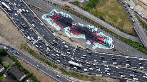Street Artist Invades Parisian Highway With Massive Optical Illusion